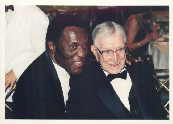 Rafer Johnson and legendary UCLA men's basketball coach John Wooden