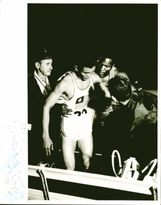 Rafer Johnson helping UCLA teammate CK Yang at the end of a race